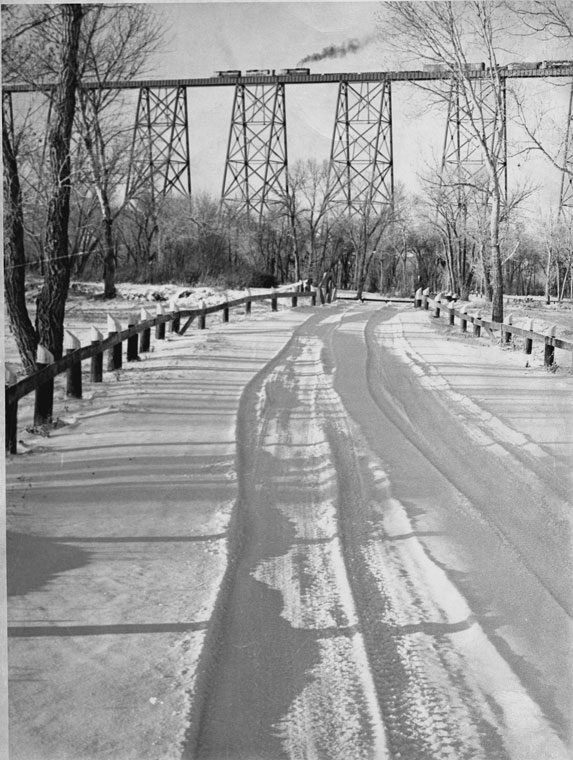 Snow Covered Road In Indian Battle Park; Viaduct In Background