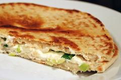 bread(0.0), gã¶zleme(0.0), pupusa(0.0), ciabatta(0.0), roti canai(0.0), tortilla de patatas(0.0), meal(1.0), breakfast(1.0), flatbread(1.0), tortilla(1.0), roti prata(1.0), baked goods(1.0), food(1.0), piadina(1.0), dish(1.0), quesadilla(1.0), naan(1.0), cuisine(1.0),
