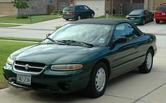 automobile(1.0), automotive exterior(1.0), executive car(1.0), vehicle(1.0), chrysler sebring(1.0), full-size car(1.0), compact car(1.0), sedan(1.0), land vehicle(1.0), coupã©(1.0), convertible(1.0),