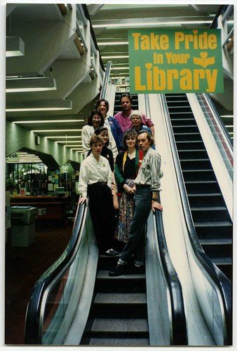 Staff group on escalator, Central Library. Flickr CCl-150-702