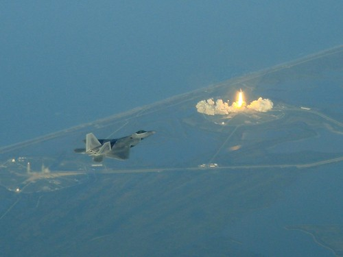 F-22 and a space shuttle take off by yacielcruz
