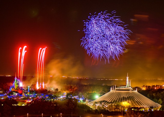 Fireworks over Cinderella Castle and Space Mountain in Magic Kingdom