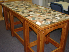 end table(0.0), billiard table(0.0), floor(1.0), furniture(1.0), wood(1.0), room(1.0), wood stain(1.0), table(1.0), hardwood(1.0),