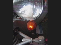 light fixture(1.0), automotive lighting(1.0), light(1.0), amber(1.0), glass(1.0), headlamp(1.0), lighting(1.0),