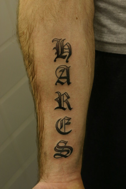 old english lettering shaded tattoo forearm Tattooed by Johnny at
