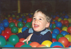 infant(0.0), toddler(0.0), child(1.0), play(1.0), ball pit(1.0), person(1.0), ball(1.0), toy(1.0),