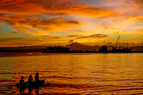 blue sunset orange silhouette yellow canon 350d three pier philippines seawall rebelxt 1785 bangka leyte ormoc flickrsbest ormocbay ormocanon easternvisayas cebuferries ormocphotographicsociety ormocpier