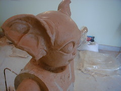 wood(0.0), pottery(0.0), ceramic(0.0), carving(1.0), art(1.0), clay(1.0), sculpture(1.0), stone carving(1.0), statue(1.0),