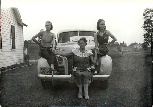 three women on a car