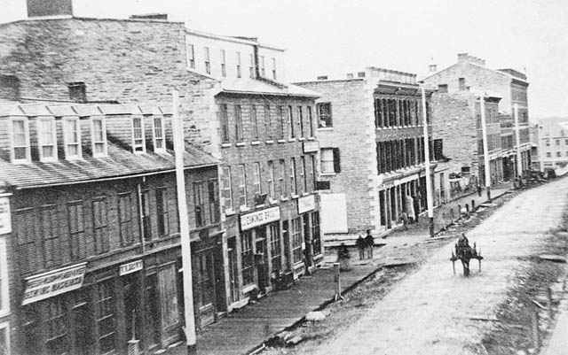 A photograph of the corner of Metcalfe and Sparks streets, 1864