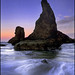 Shark fin-shaped seastack at dawn on the Oregon Coast