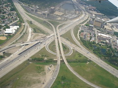 race track(0.0), viaduct(0.0), skyway(0.0), cable-stayed bridge(0.0), metropolitan area(1.0), highway(1.0), junction(1.0), bird's-eye view(1.0), road(1.0), lane(1.0), controlled-access highway(1.0), overpass(1.0), aerial photography(1.0), infrastructure(1.0), bridge(1.0), intersection(1.0),