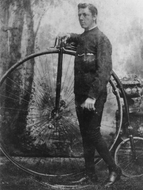 Cyclist posing with a penny farthing bicycle, Queensland