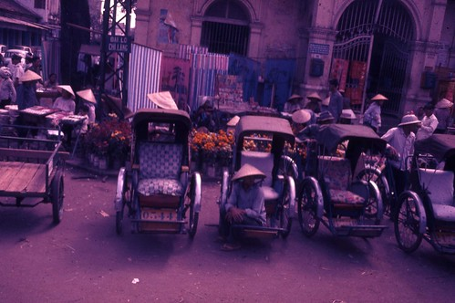 Tricycle riders waiting for a fare at a market place in Saigon 1967 by 7th Surgical Hospital (MA)  Vietnam