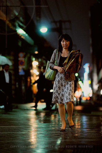 You'll be needing that umbrella soon, madam: Yurakucho, Tokyo
