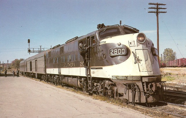 SR0012 A two car train holds down the service behind E6A No. 2800 on the Memphis – Chattanooga leg of the overnight Birmingham – New York Birmingham Special. The scene is at Corinth, Miss, October 30, 1966 (William I. White – Mac Owen Coll.)