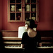 wavering shadows loom, a piano plays in an empty room