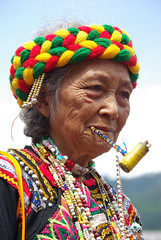 hairstyle(0.0), carnival(0.0), tribal chief(0.0), people(0.0), tribe(1.0), clothing(1.0), tradition(1.0), head(1.0), person(1.0),