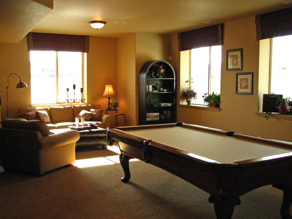 Living area in basement of the Saddletree Homes model in Flying Horse