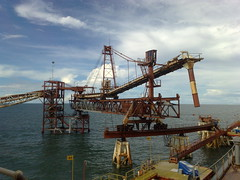 crane vessel (floating)(0.0), transport(0.0), freight transport(0.0), petroleum(0.0), jackup rig(0.0), dredging(0.0), floating production storage and offloading(0.0), oil field(0.0), oil rig(0.0), port(1.0), offshore drilling(1.0), construction equipment(1.0), crane(1.0),
