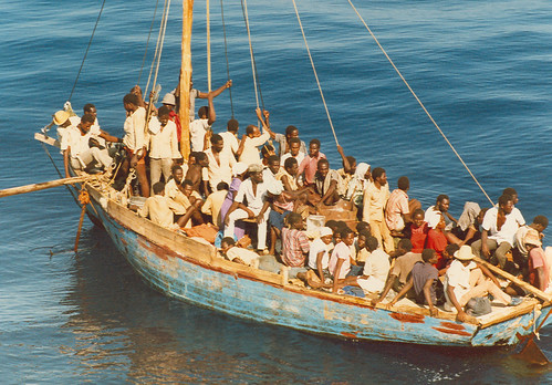 A group of Haitian migrants is approached by a U.S. Coast Guard Ship