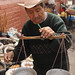 Man Weighing Pepian Ingredients- Xela, Guatemala