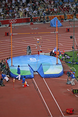 sprint(0.0), physical exercise(0.0), athletics(1.0), track and field athletics(1.0), sport venue(1.0), championship(1.0), sports(1.0), pole vault(1.0), high jump(1.0), person(1.0), athlete(1.0),