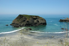 Turquoise waves peacefully overlap at an island, Pacific Ocean, coast, California, USA