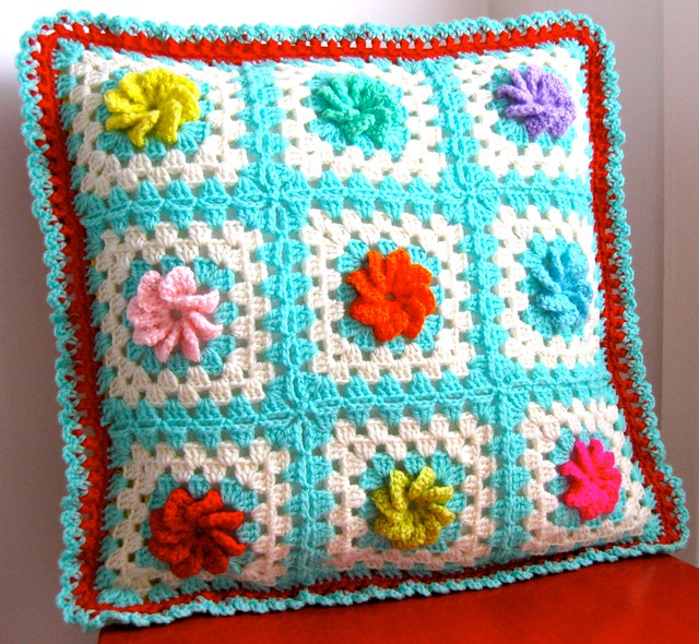 crocheted rose cushion