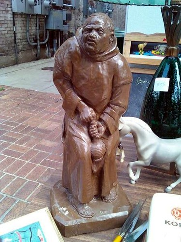 95 dollar statue of monk wanking into bottle of chianti