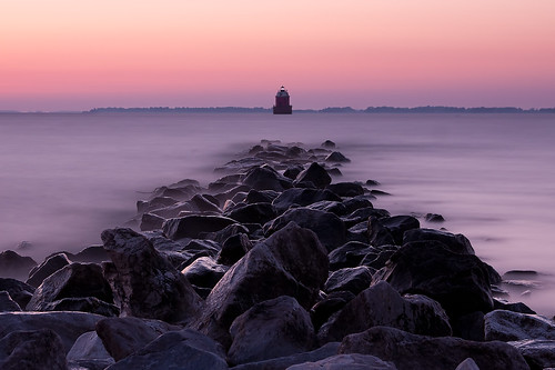 longexposure morning lighthouse water sunrise dawn bay rocks soft jetty maryland tranquility chesapeake chesapeakebay sandypoint