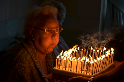 Gran blows out her candles on her 80th birthday cake