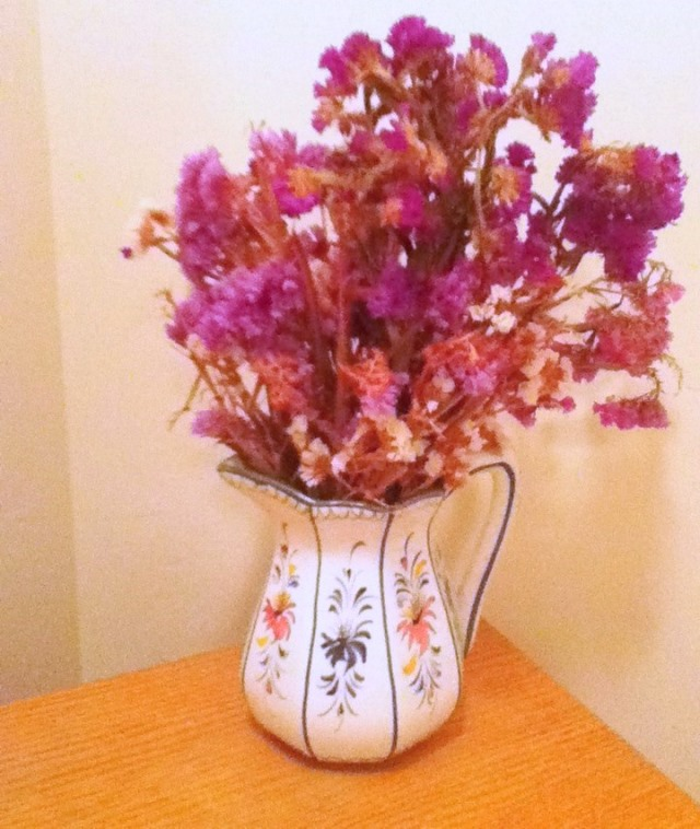 pitcher of purple flowers