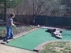 lawn(0.0), backyard(1.0), grass(1.0), sports(1.0), recreation(1.0), outdoor recreation(1.0), golf(1.0), miniature golf(1.0),