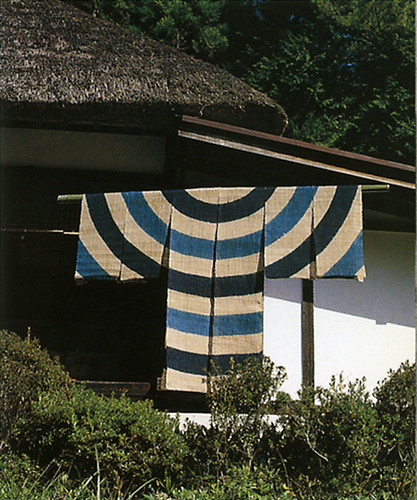 Traditional indigo textile hanging, doubling as scarecrow, Japan