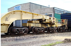 GEGX # 21154, depressed center flat car showing trucks and span bolsters in CSX yard at Erwin, Tennessee, April 2009