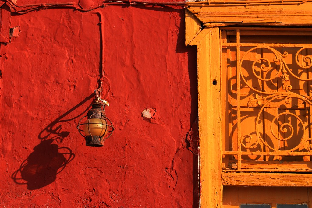 Red wall and lamp