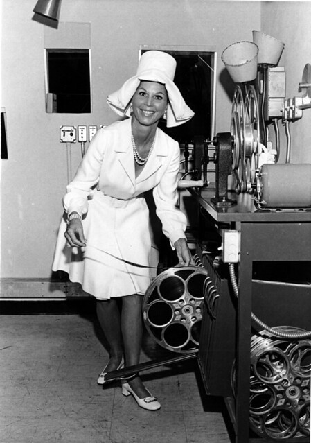 Unidentified woman in projection booth at Chris McGuire's Theatre: Fort Lauderdale, Florida