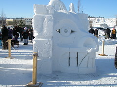 A very nice snow sculpture of a First Nation mask
