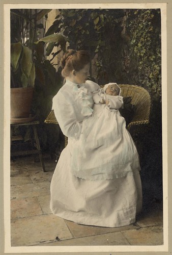 Vintage Portrait of a Mother holding a Baby Child on the Patio Outside