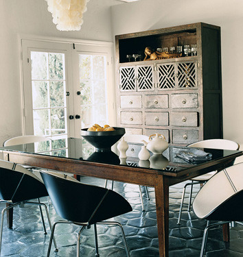 Modern mix L.A. dining room: Stained tile floors + shell chandelier