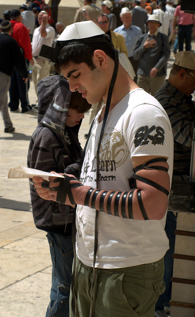 Young Jew at Western Wall praying with Tefillin