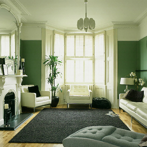 Green living room monochrome palette white accents Shades of green paint for living room