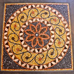 tapestry(0.0), carving(0.0), textile(0.0), prayer rug(0.0), design(0.0), carpet(0.0), art(1.0), mosaic(1.0), symmetry(1.0), circle(1.0),