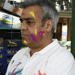 Pritam checking up the colours for the Holi festival!