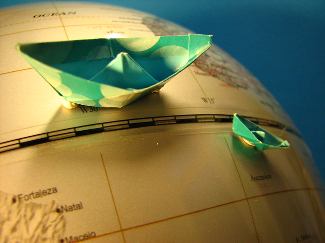 Origami boats and globe.