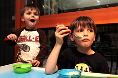 brothers eating dessert and watching toy story