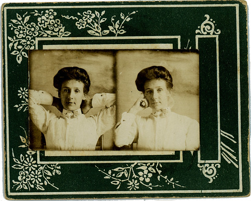 two photobooth portraits mounted on one card