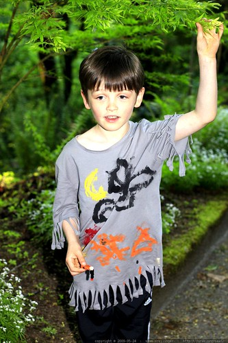 nick wearing a native american shirt he made in kindergarten