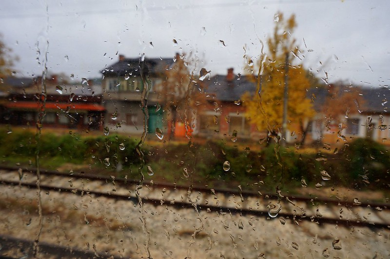 Rain drops on the window as seen from a moving train to Sofia.